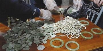 ...绿洲珠宝行被劫物品.-宁波珠宝大劫案 嫌犯的双面人生