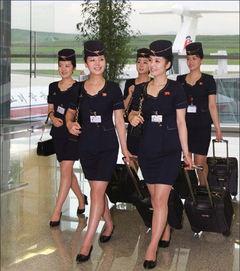 亮相的高丽航空空姐-韩媒热议朝鲜空姐亮相 裙子比以往短了许多