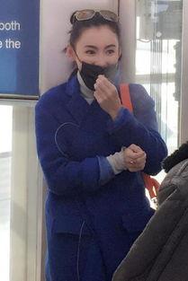 北京太冷 把张柏芝冻得哈气搓手捂耳朵