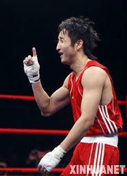 ...国选手邹市明在51公斤级半决赛中战胜菲律宾选手塔纳莫尔,晋级决...