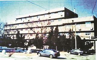 表情-共和国科学第一楼拆除暂停 南墙将被复制到新楼