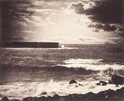 ...事实上,他分别用负片拍摄了天空和海景,然后将胶片拼在一起洗印...