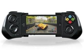 fd78a19e0002498e-MOGA游戏控制手柄包括两种操纵杆,前面板有A、B、X和Y按钮,边...